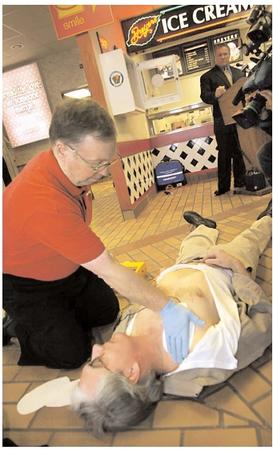 According to the American Heart Association, heart disease is the most common cause of cardiac arrest, and 95 percent of cardiac arrest patients die before they reach the hospital. That high mortality rate has prompted the placement of portable defibrillators in places such as schools, airplanes, police cars, and in this service plaza along the Pennsylvania Turnpike. [Photograph by Keith Srakocic. AP/Wide World Photos. Reproduced by permission.]